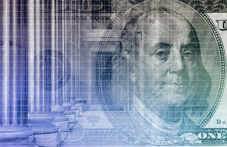 close-up of bejamin franklin on a bill overlaid on top of a government building